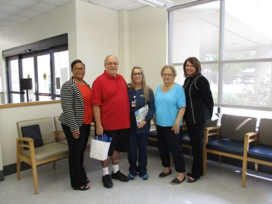 From left are: Vice President of Clinics Kanna Page, Robert Sarafinis, Clinic LPN Anna Sellers, Corrine Sarafinis and President/CEO Michele Sutton. Not pictured is Dr. Hugo Valdes.